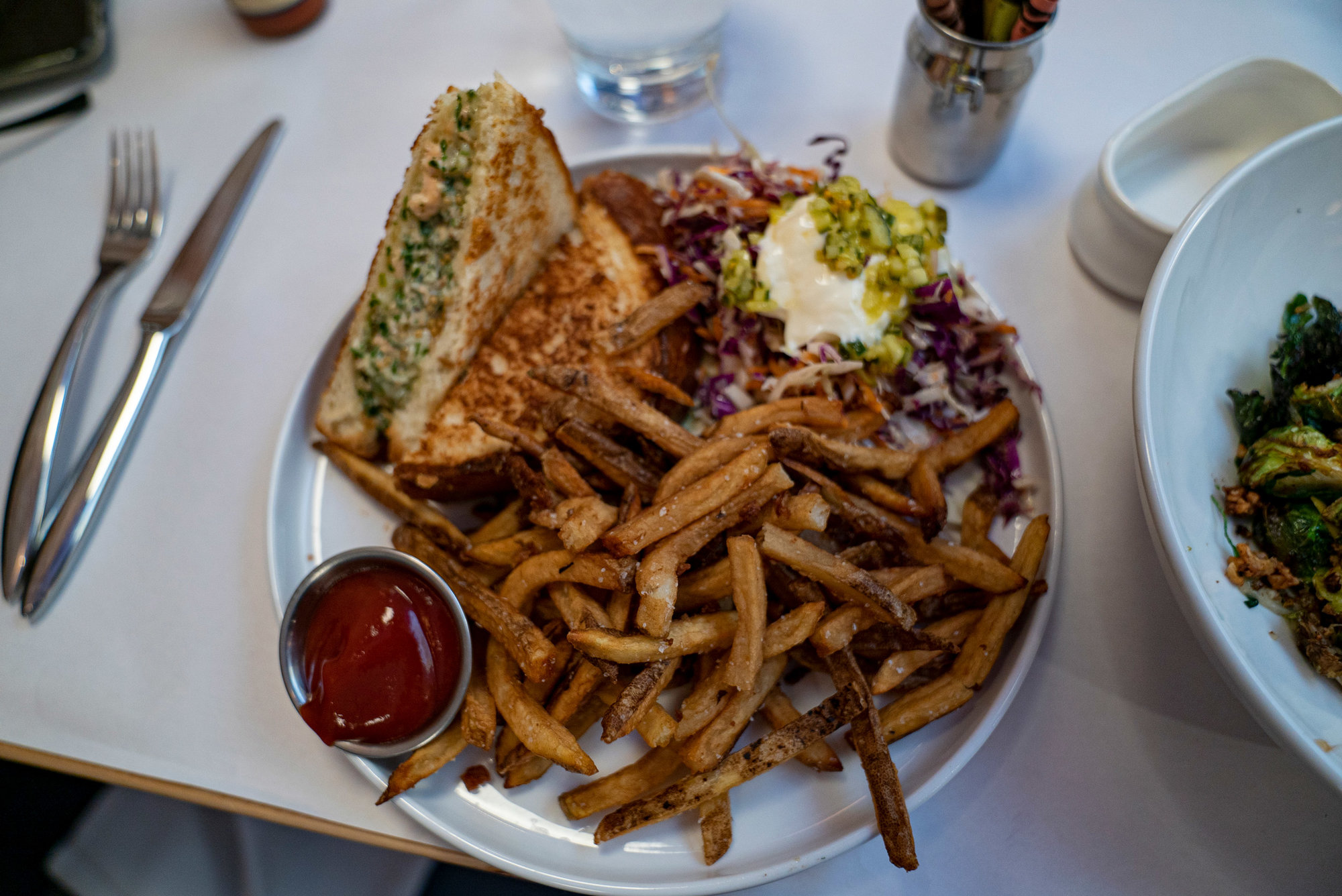 Jax Fish House and Oyster Bar has an array of fish sandwiches like this Salmon sammy | Colorado Springs Homes
